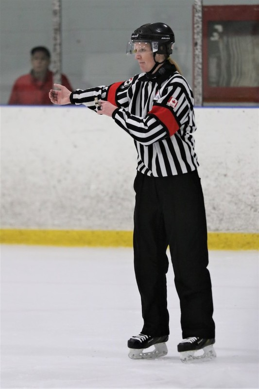 Content courtney    cassidy   ice hockey referees   sisters   pic  30